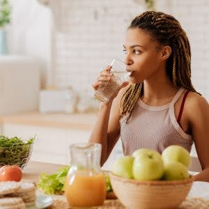 woman combating nausea and vomiting after stroke by eating healthy
