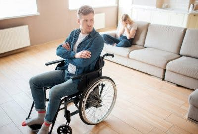 man in wheelchair pouting and looking upset, a sign of orbitofrontal cortex damage