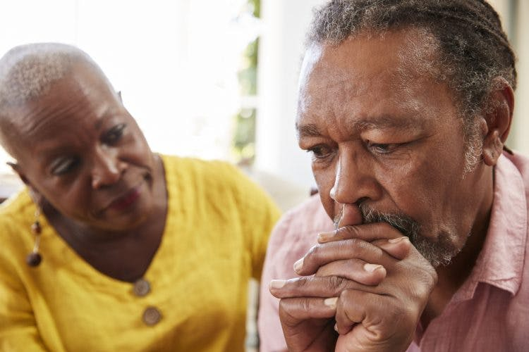 Senior woman comforting husband who has hippocampus brain injury