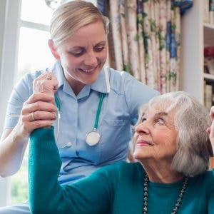nurse helping patient with somatosensory cortex damage
