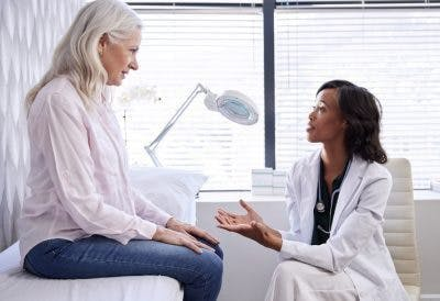 doctor and patient discussing how long she will need to use hormone therapy