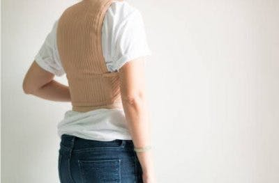 individual with spinal cord injury wearing spinal brace to manage scoliosis