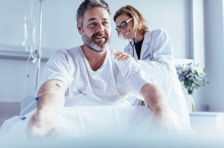 doctor checking male patient for brain stem injury recovery signs