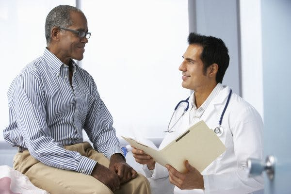 doctor explaining results of test to patient that shows he has pituitary dysfunction after brain injury