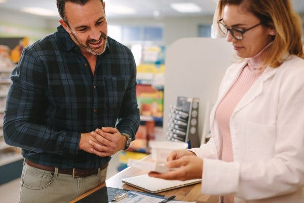 Pharmacist giving advice about Ritalin for brain injury to customer