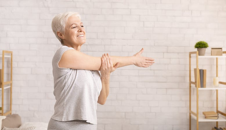 stroke patient works on arm exercises at home