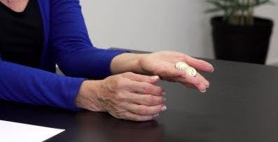 therapist holding quarters in her palm