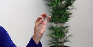 occupational therapist touching thumb to index fingertip for hand exercise
