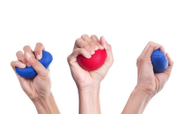 three hands squeezing therapy balls for strengthening exercises