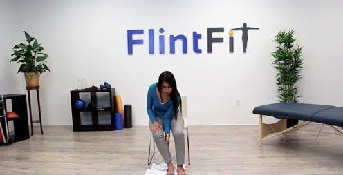 therapist sliding leg back to show stroke exercises for legs
