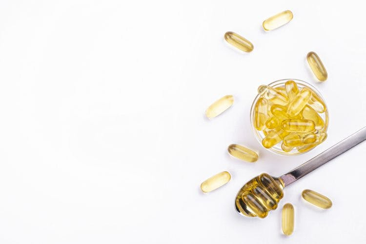 spoonful of fish oil pills with omega 3s