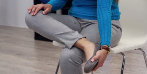 therapist moving foot down during foot drop exercise
