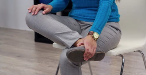 therapist in final position of foot drop exercises
