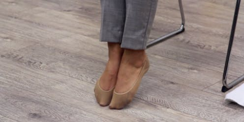 toes pointed with heels off the floor for foot drop therapy exercise