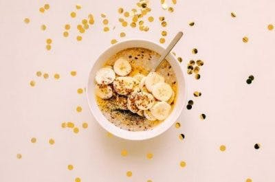 bowl of bananas and cereal, a rich source of magnesium for brain injury recovery