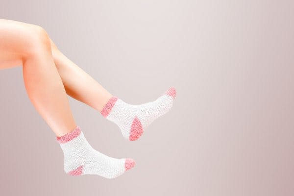 legs of spinal cord injury patient with cold feet wearing socks