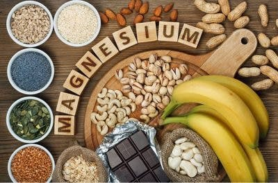 table full of foods like bananas, cashews and dark chocolate that are high in magnesium