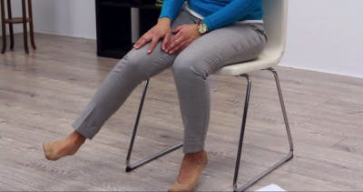 therapist demonstrating hip abduction exercises