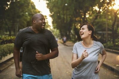 couple jogging together to prevent weight gain after brain injury