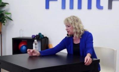 therapist pushing water bottle across table