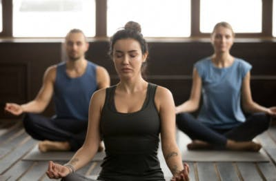 women meditating for stroke recovery at home