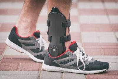 Close-up of ankle brace on man's foot