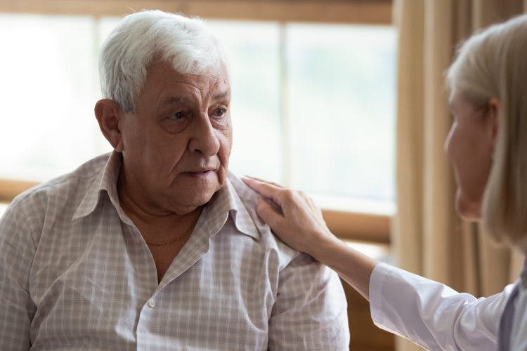 Doctor comforting stroke patient and telling him about second stroke survival