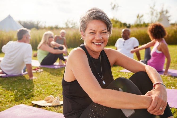 stroke patient sitting outside on yoga mat 5 years after stroke