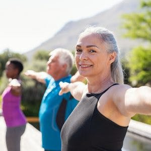 woman in outdoor fitness class doing balance exercises for stroke patients