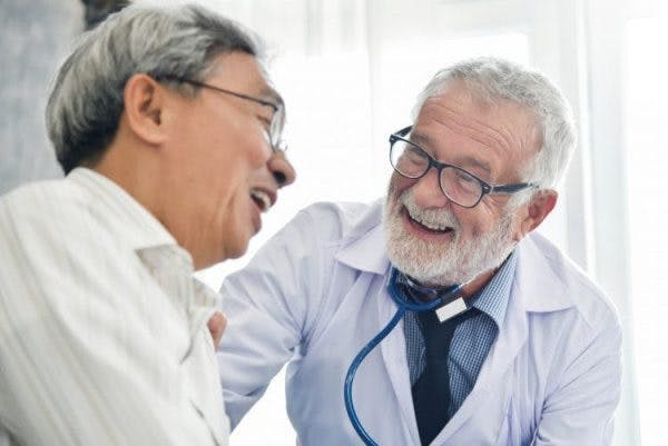 friendly speech language pathologist talking with stroke patient about recovery