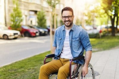 man with severe spinal cord injury using wheelchair