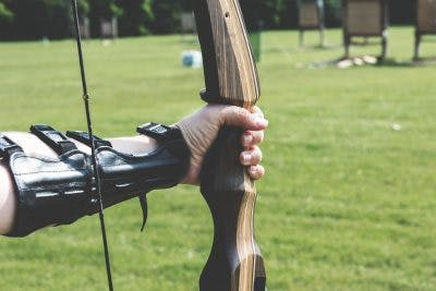 person with cerebral palsy practicing archery