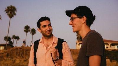 two friends talking on beach