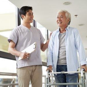 Young physical therapist talking to patient about long-term goals for brain injury patients