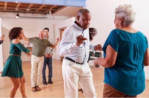 stroke patients in dance room dancing slowly together