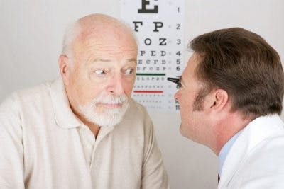 doctor examining elderly patients vision to see if he suffered a head injury