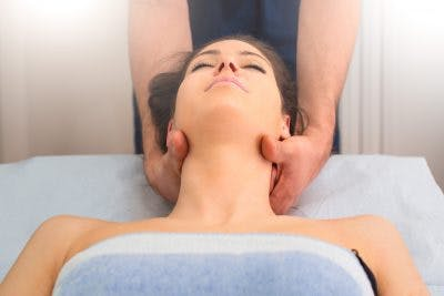 woman getting neck therapy to help with numbness after head injury