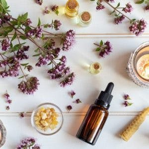 pieces of lavender arranged with natural remedies on white background