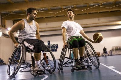 man with thoracic spinal cord injury playing basketball