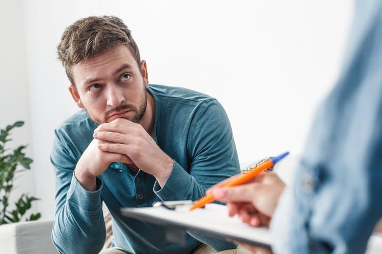 man listening to psychologist explain prefrontal cortex damage