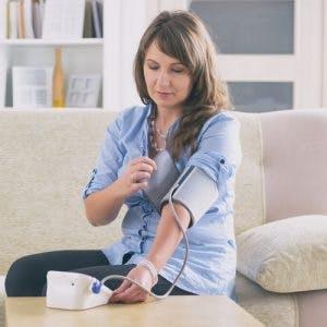 woman with autonomic dysreflexia taking blood pressure measurement