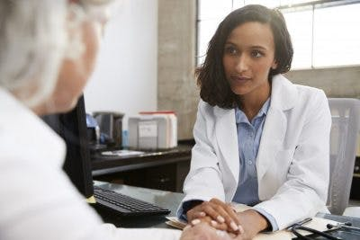 Doctor listening to stroke patient's concern