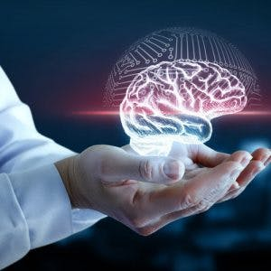 Doctor holding hologram of brain to represent frontal lobe damage recovery