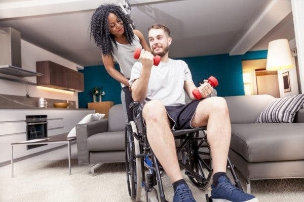patient practicing spinal cord injury exercises to improve mobility