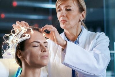 doctor applying magnetic therapy to stroke patient
