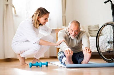 spinal cord injury patient stretching at physiotherapy