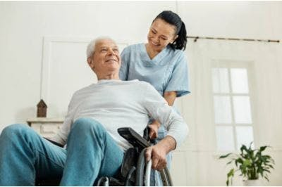 stroke patient in wheelchair working on curing stroke side effects with therapist