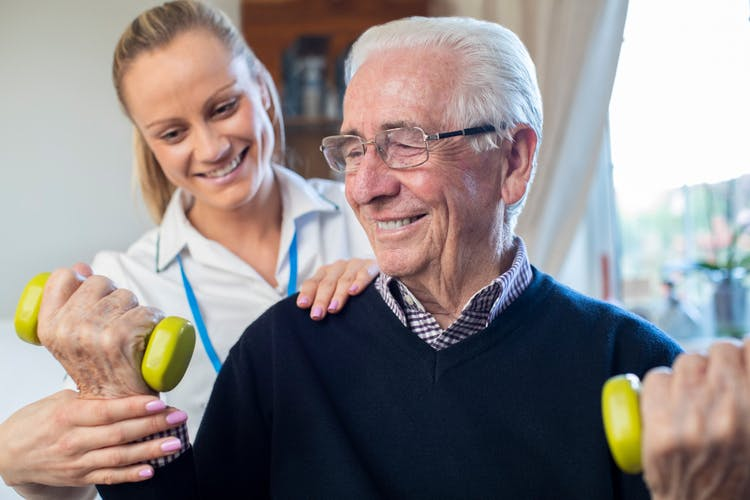 Therapist helping patient with stroke rehabilitation techniques