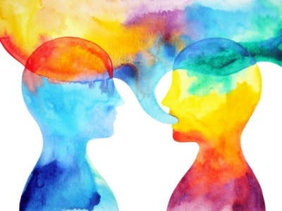 colorful watercolor painting of two figures talking. the colors in speech bubble are bleeding together, representing aphasia, a side effect of left-side brain injury
