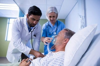 doctors giving oxygen to man in minimally conscious state